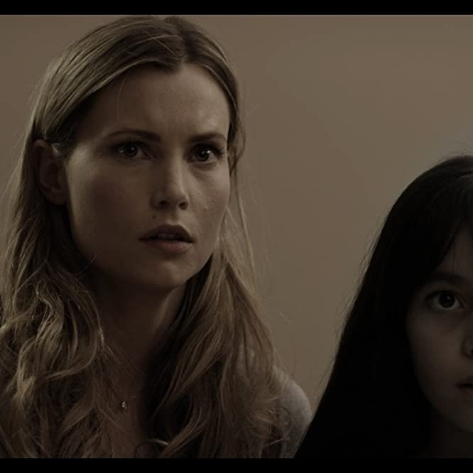 Harriet MacMasters-Green and Sabrina Jolie Perez in The Haunting of Helena (2012)