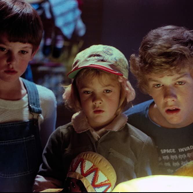 Drew Barrymore, Henry Thomas, and Robert MacNaughton in E.T. the Extra-Terrestrial (1982)