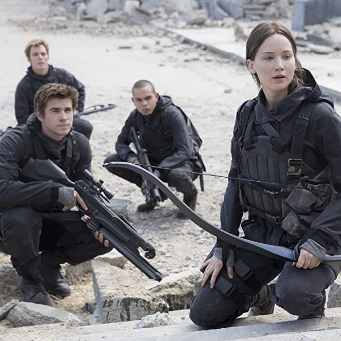Evan Ross, Jennifer Lawrence, Liam Hemsworth, and Sam Claflin in The Hunger Games: Mockingjay - Part 2 (2015)