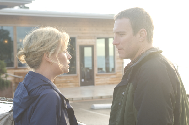 Charlize Theron and John Corbett in The Burning Plain (2008)