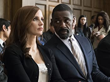 Idris Elba and Jessica Chastain in Molly's Game (2017)