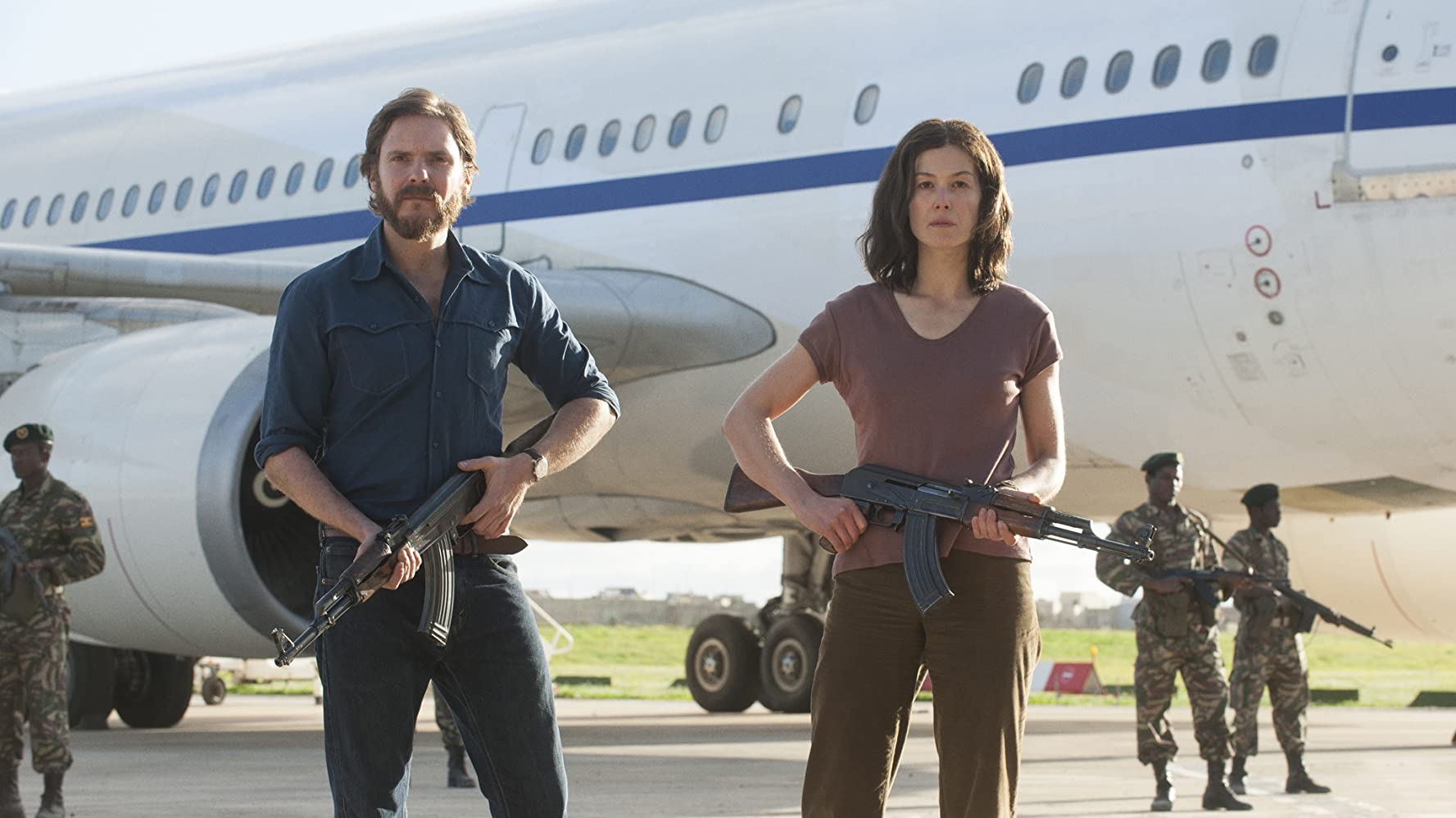 Daniel Brühl and Rosamund Pike in Entebbe (2018)