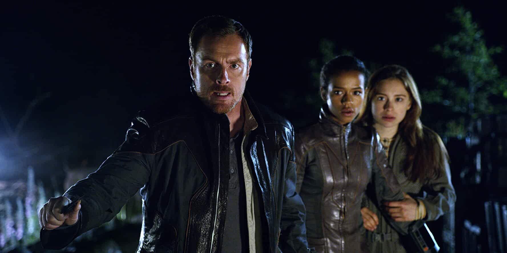 Toby Stephens, Mina Sundwall, and Taylor Russell in Lost in Space (2018)