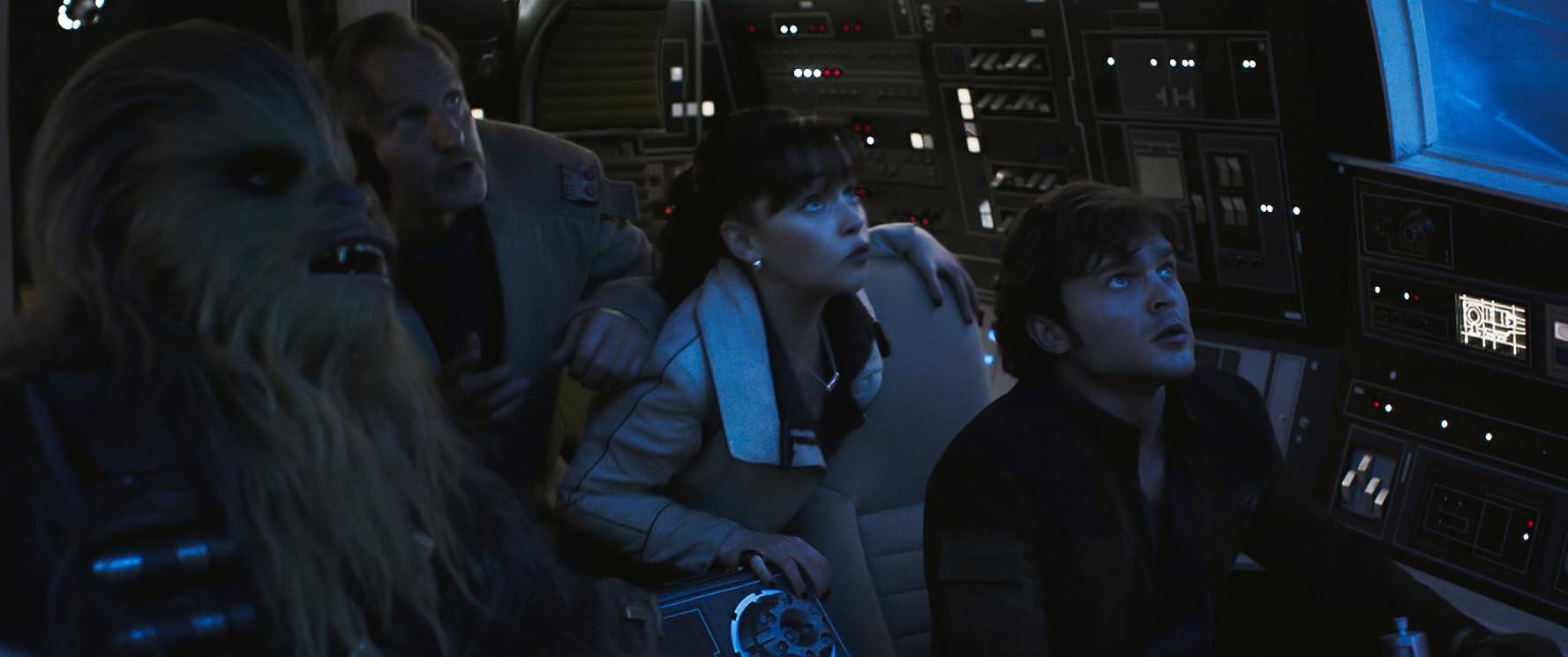 Woody Harrelson, Alden Ehrenreich, Emilia Clarke, and Joonas Suotamo in Solo: A Star Wars Story (2018)