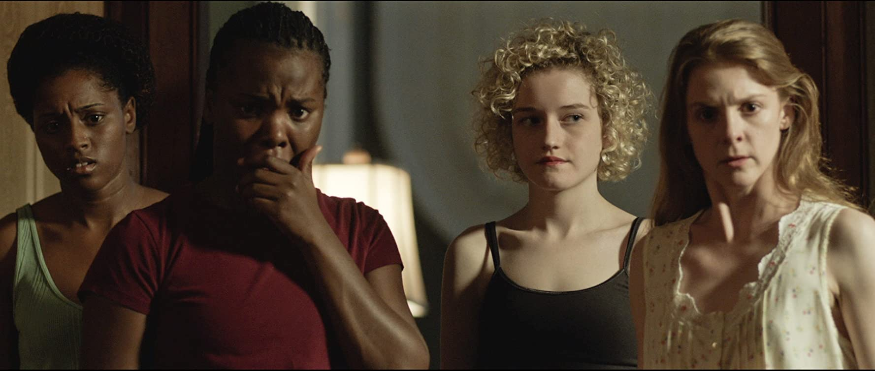 Ashley Bell, Julia Garner, Erica Michelle, and Sharice A. Williams in The Last Exorcism Part II (2013)
