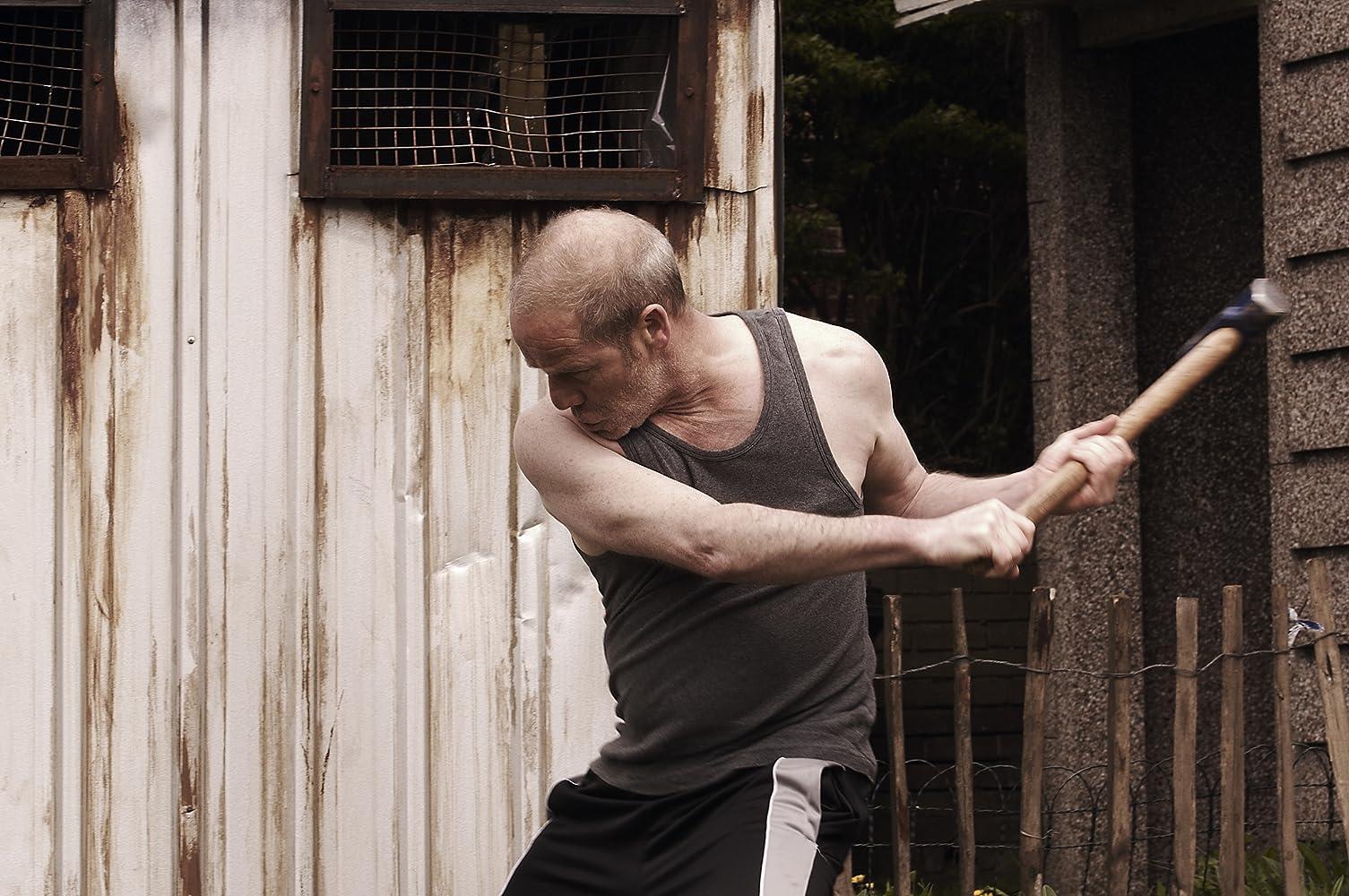 Peter Mullan in Tyrannosaur (2011)