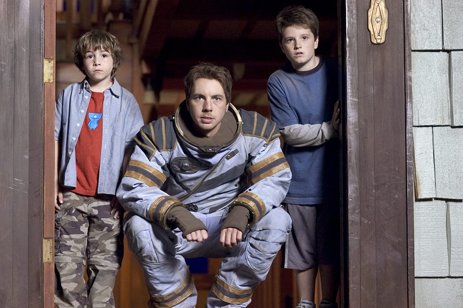 Dax Shepard, Josh Hutcherson, and Jonah Bobo in Zathura: A Space Adventure (2005)