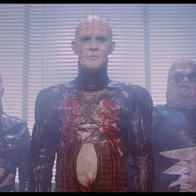 Simon Bamford, Doug Bradley, and Grace Kirby in Hellraiser (1987)