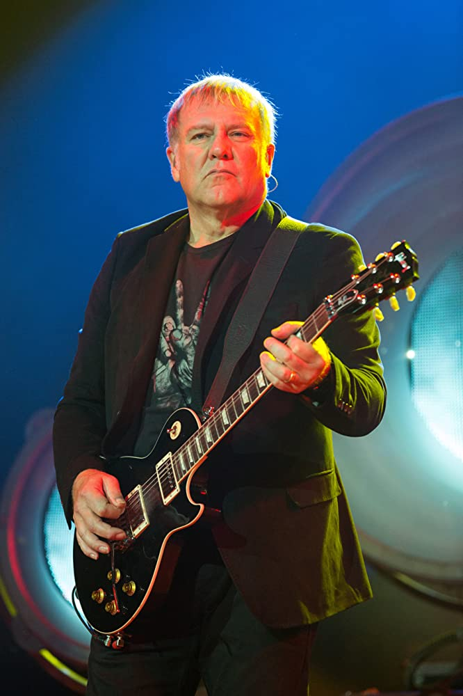 The 64-year old son of father (?) and mother(?), 183 cm tall Alex Lifeson in 2018 photo