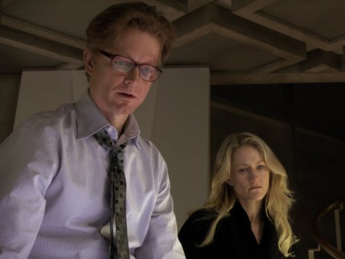 Eric Stoltz and Paula Malcomson in Caprica (2009)