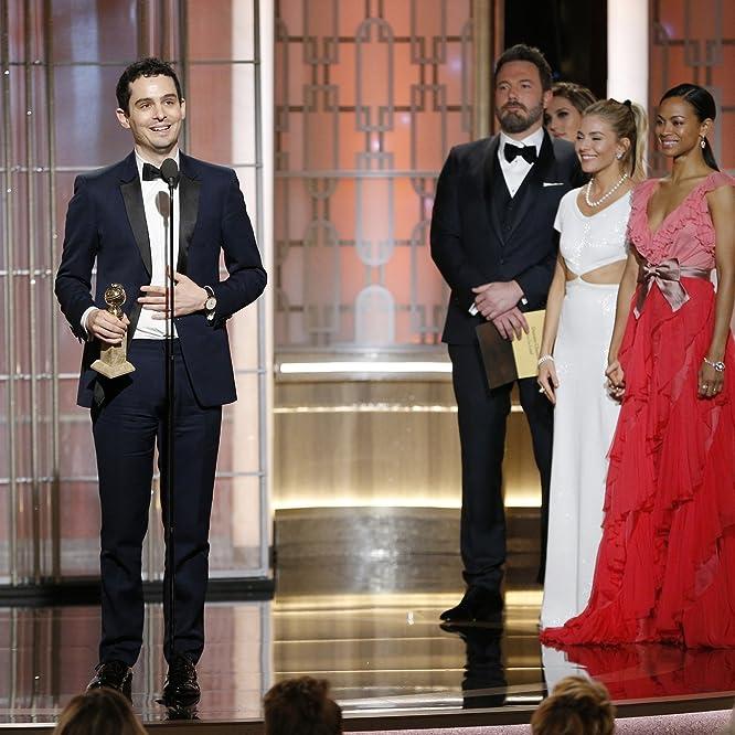 Ben Affleck, Zoe Saldana, Sienna Miller, and Damien Chazelle at an event for The 74th Golden Globe Awards (2017)