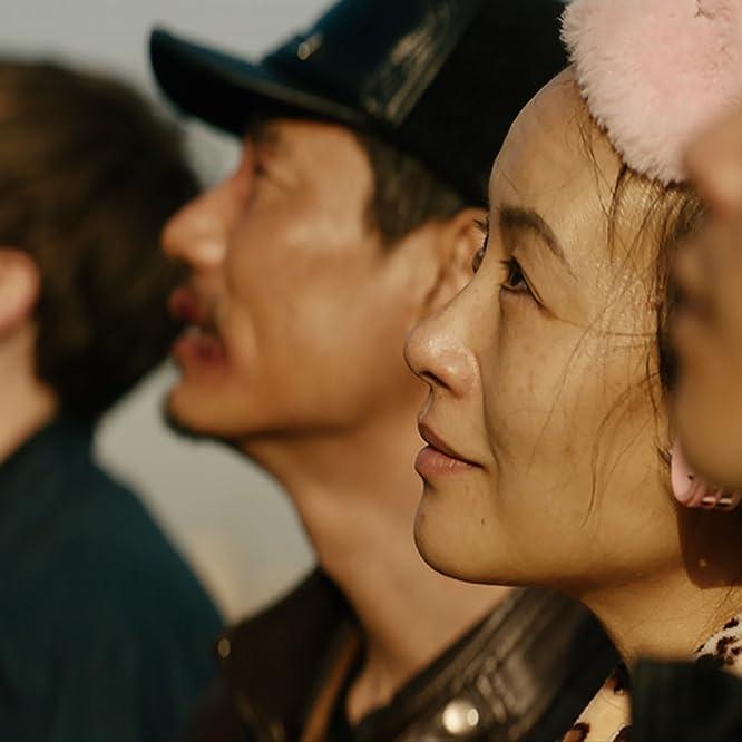 Mason Lee, Vivian Wu, and David Rysdahl in Dead Pigs (2018)