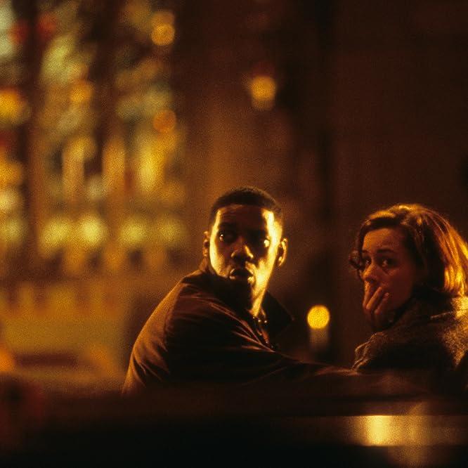 Denzel Washington and Embeth Davidtz in Fallen (1998)
