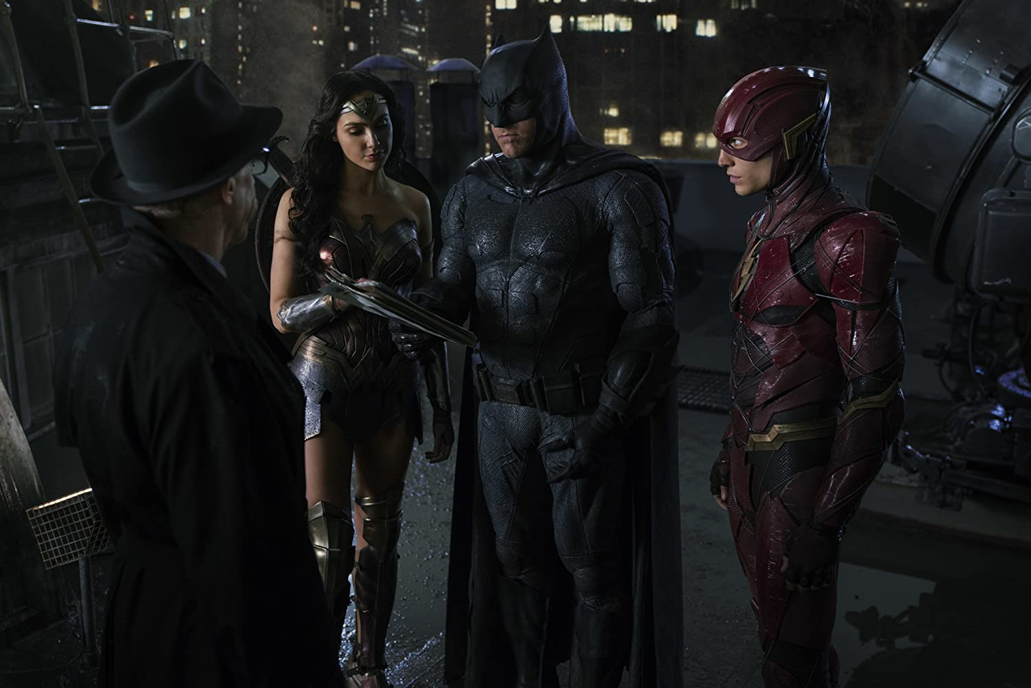 Ben Affleck, J.K. Simmons, Gal Gadot, and Ezra Miller in Justice League (2017)