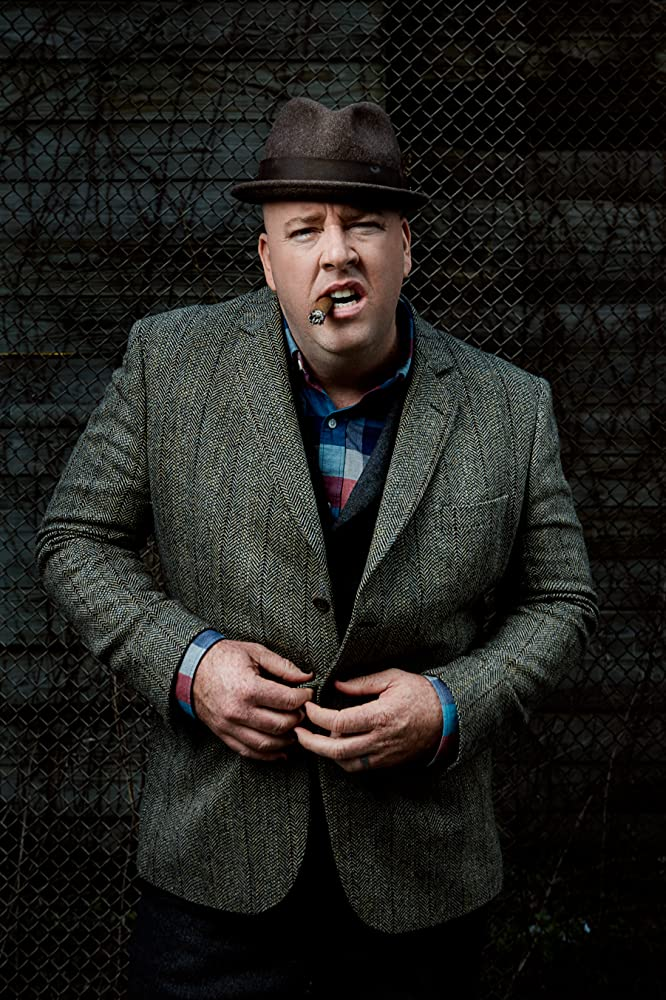 Chris Sullivan smoking a cigarette (or weed)