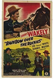 Rainbow Over the Rockies Poster