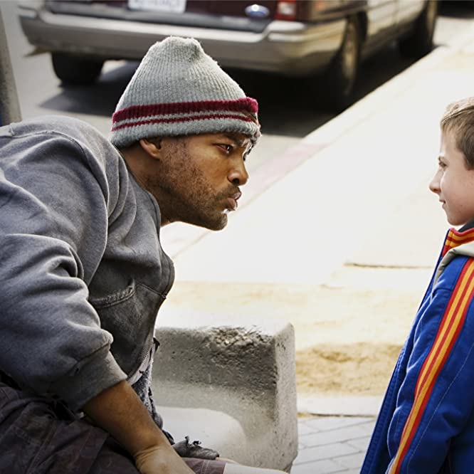 Will Smith and Atticus Shaffer in Hancock (2008)