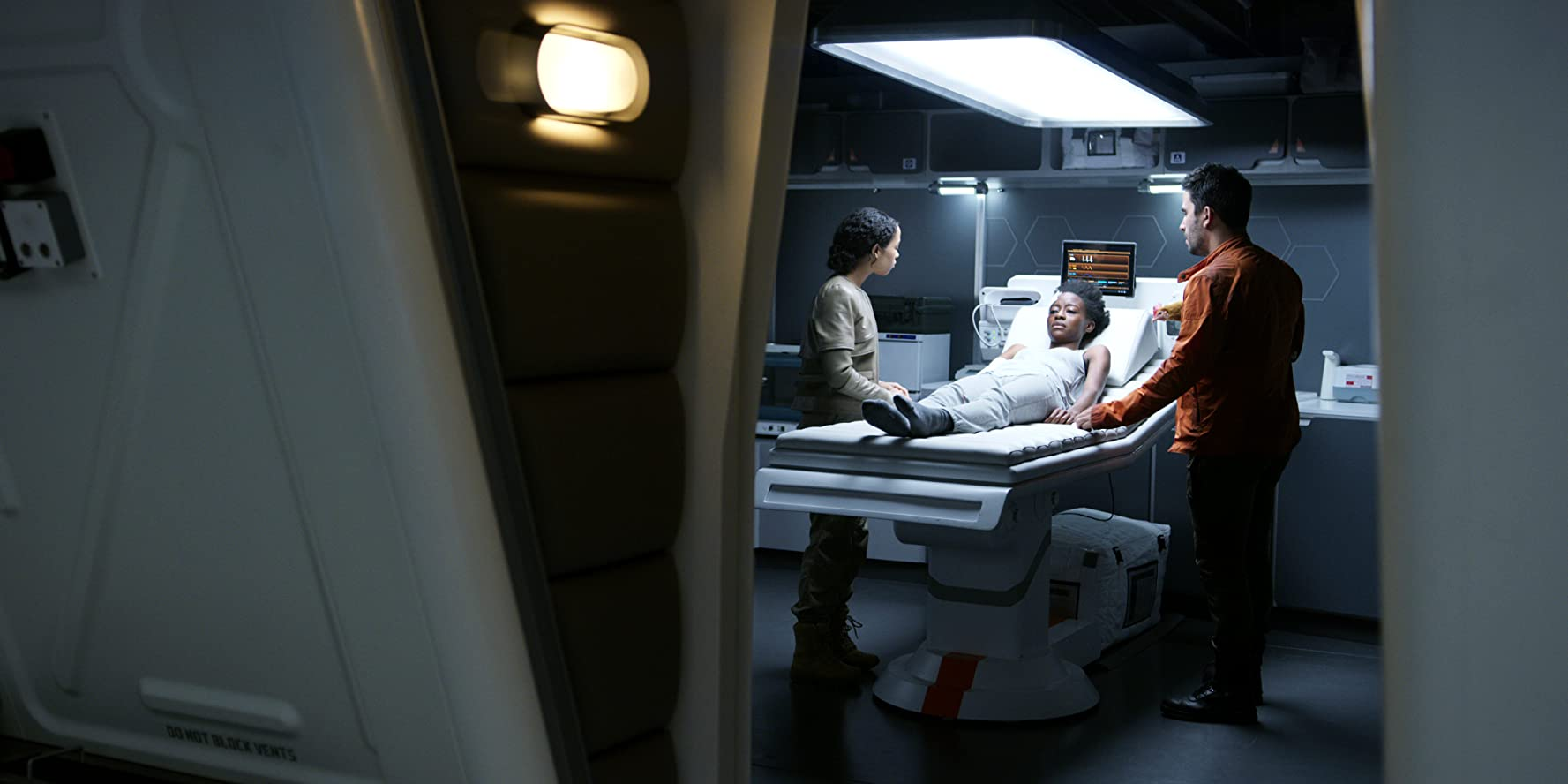 Ignacio Serricchio, Sibongile Mlambo, and Taylor Russell in Lost in Space (2018)