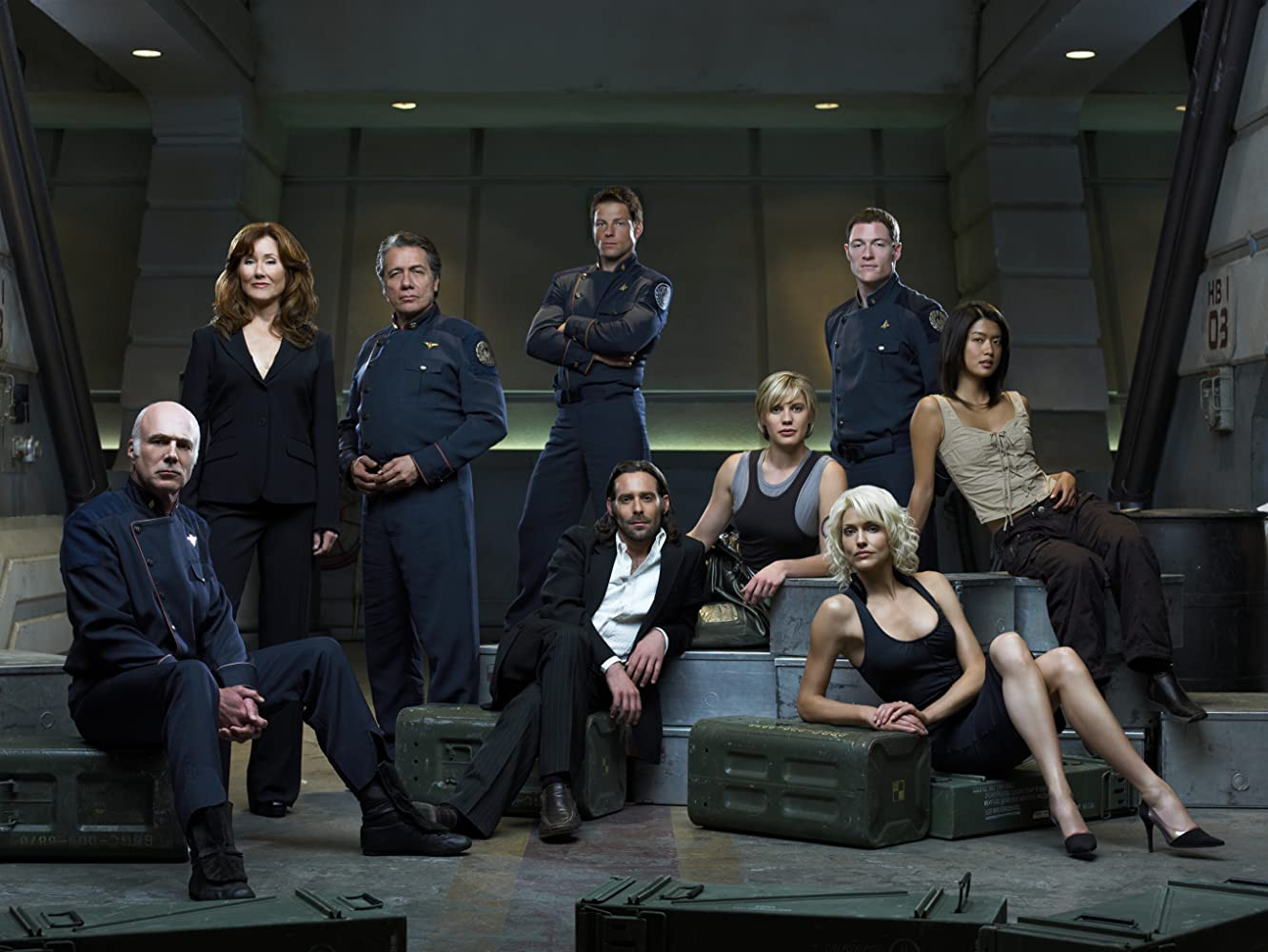Mary McDonnell, Edward James Olmos, Jamie Bamber, James Callis, Michael Hogan, Grace Park, Tahmoh Penikett, and Tricia Helfer in Battlestar Galactica (2004)